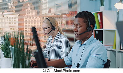 Medium shot of friendly african man working in call center