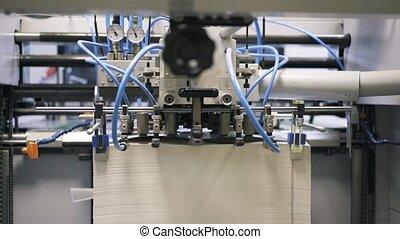 Medium shot of printing plant machine working - Medium shot...
