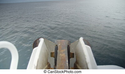Medium shot of the ocean and the motor of a yacht