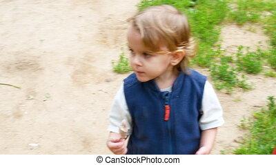 Medium shot of toddler eating ice cream - Medium shot of...