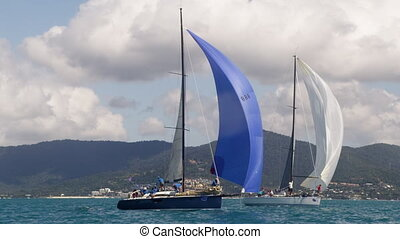 Medium shot of two sailboats - A shot of two sailboats while...