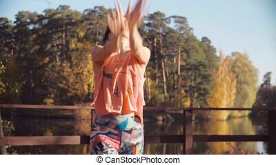 Portrait of a woman dancing on the bridge