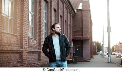 Medium shot portrait of bearded European man. Male in...