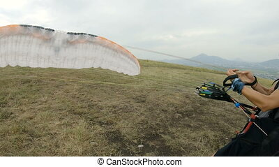 medium shot professional paraglider pilot prepares for...