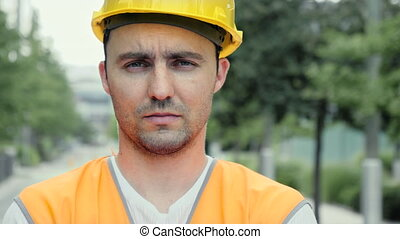 Serious confident construction worker looking co camera.