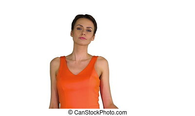 Medium shot. Short-haircutted pretty woman dancing in orange sundress on white background. Professional shot in 4K resolution. 023. You can use it e.g. in your commercial video, business, presentation, broadcast