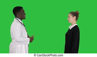Acquaintance doctor with a patient on a Green Screen, Chroma Key.