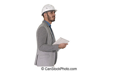 Architect walking with tablet and checking what is built on white background.