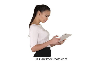 Beautiful young adult womann having fun playing game with tablet on white background.