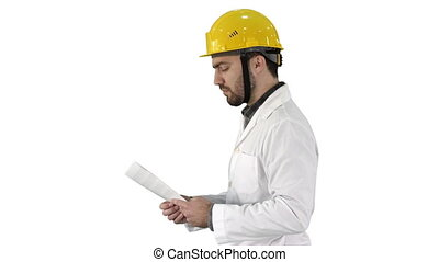 Contractor engineer walking with papers and checking arround...