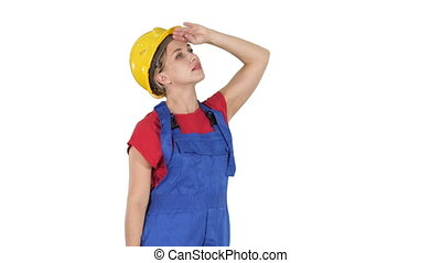 Engineer construction worker woman looking up amazed on white background.