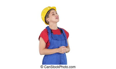 Engineer construction worker woman looking up at something amazing and laughing on white background.
