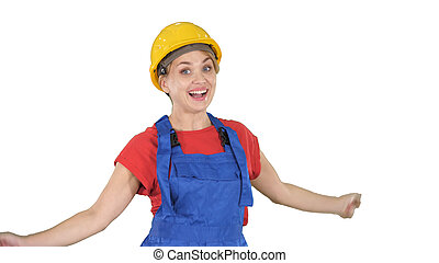 Female construction worker dancing happy on white background.