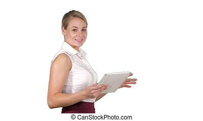 Female office clerk walking with tablet and smiling broadly...