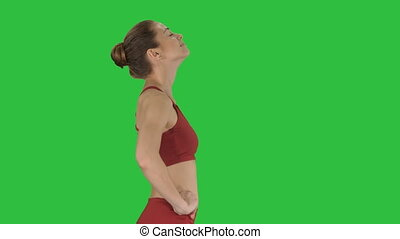 Female walking and doing neck stretching exercise to release...