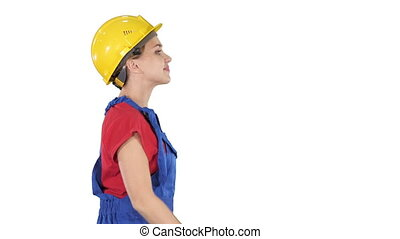 Female worker in hardhat walking happy Construction and...