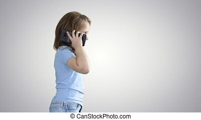 Little girl talk phone and walking on gradient background. -...