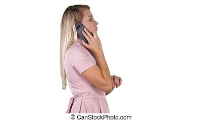 Lovely woman walking and talking on the phone on white background.
