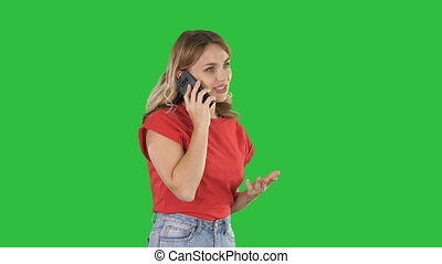 Pretty woman talking on the phone on a Green Screen, Chroma Key.