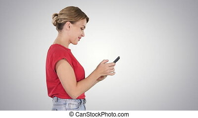 Pretty woman using cell phone on gradient background. -...