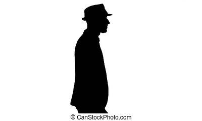 Silhouette Casual arabic man in hat walking. - Medium shot....