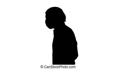 Silhouette Handsome doctor wearing his uniform and wearing a mask he is walking.