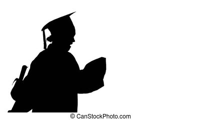 Medium shot. Side view. Silhouette Happy female student in graduation robe walking and cheering with her diploma. Professional shot in 4K resolution. 043. You can use it e.g. in your medical, commercial video, business, presentation, broadcast