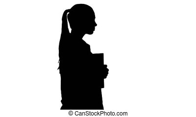 Silhouette Happy smiling female doctor walking holding notebooks or documents.