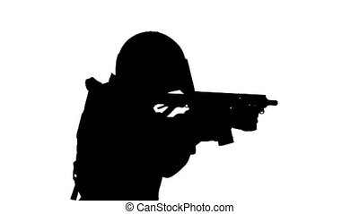 Medium shot. Side view. Silhouette Police anti terrorism squad fighter shooting from rifle. Professional shot in 4K resolution. 067. You can use it e.g. in your medical, commercial video, business, presentation, broadcast