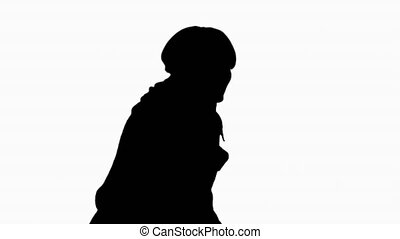 Silhouette Pregnant woman in labor calling hospital.