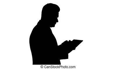 Silhouette Smart senior businessman using a technology...