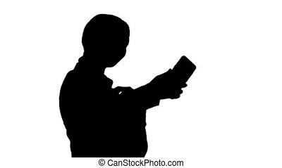Medium shot. Side view. Silhouette Smiling Businesswoman taking selfie on her phone. Professional shot in 4K resolution. 043. You can use it e.g. in your medical, commercial video, business, presentation, broadcast