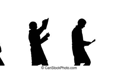 Medium shot. Side view. Silhouette Three male doctors in white robes and protective caps passing on document while dancing in a row. Professional shot in 4K resolution. 045. You can use it e.g. in your medical, commercial video, business, presentation, broadcast