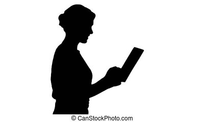 Silhouette Woman in casual clothing using digital tablet ...