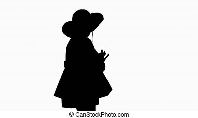 Medium shot. Side view. Silhouette Woman in summer outfit using mobile walking. Professional shot in 4K resolution. 4151. You can use it e.g. in your commercial video, business, presentation, broadcast