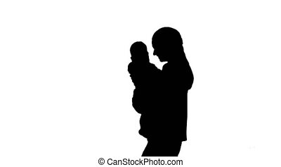 Silhouette Young mother holding her baby in hands and...