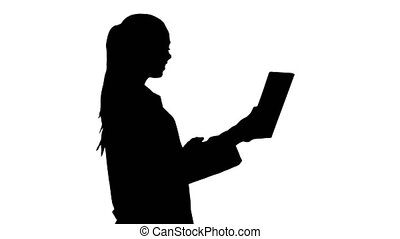 Silhouette Young woman doctor holding tablet in her hands...