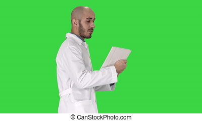 Sincere doctor making video call to his patient walking on a...