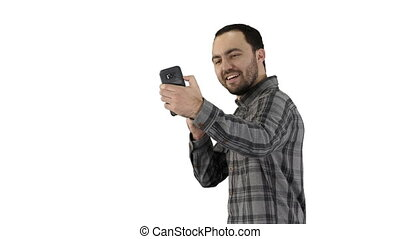 Teenage boy making a selfie when walking on white background.