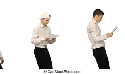 Three guys checking documents while dancing in a row on ...