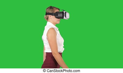 Woman in VR headset walking on a Green Screen, Chroma Key.