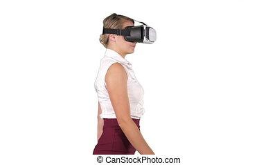 Woman in VR headset walking on white background. - Medium...