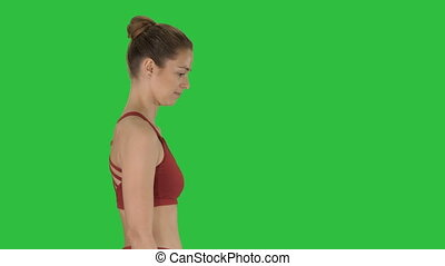 Woman yogi walking on a Green Screen, Chroma Key.