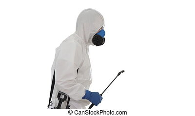 Medium shot. Side view. Worker in Hazmat Suit and Face Protection Mask Walking With Disinfection Equipment on white background. Professional shot in 4K resolution. 53. You can use it e.g. in your medical, commercial video, business, presentation, broadcast