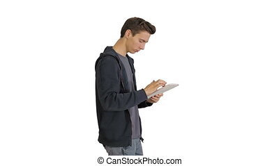 Medium shot. Side view. Young man using digital tablet while walking on white background. Professional shot in 4K resolution. 041. You can use it e.g. in your medical, commercial video, business, presentation, broadcast