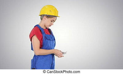 Young woman engineer or architect holding banknotes euros...