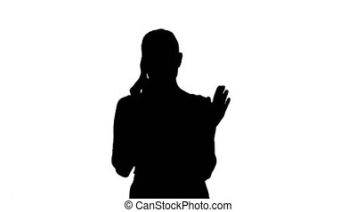 Silhouette Angry dissatisfied young woman calling customer...