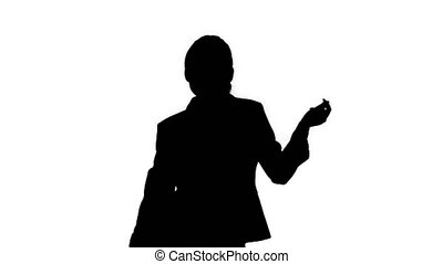 Medium shot. Silhouette Beautiful businesswoman inviting you to dance with her. Professional shot in 4K resolution. 021. You can use it e.g. in your commercial video, business, presentation, broadcast