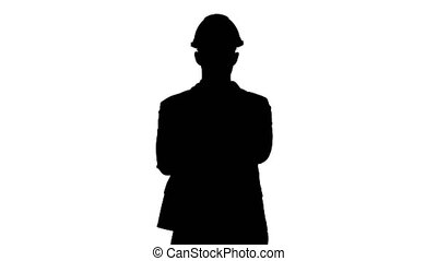 Silhouette Confident construction engineer architect young man in helmet with hands folded.