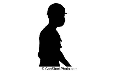 Medium shot. Silhouette Construction worker wearing a hardhat and mask walking. Professional shot in 4K resolution. 53. You can use it e.g. in your medical, commercial video, business, presentation, broadcast